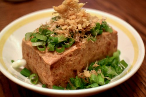 Home made deep fried tofu with grated ginger and scallions